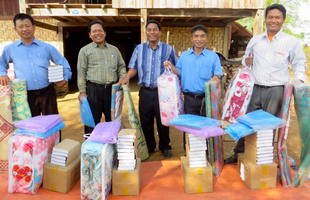 Men receiving Village Outreach Kits