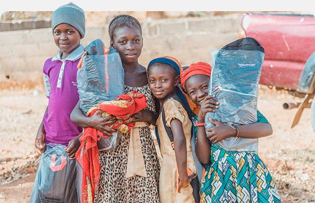 Children holding Christmas Care packs