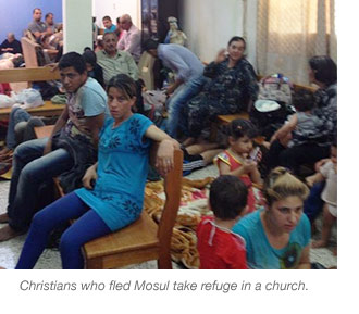 Christians who fled Mosul take refuge in a church